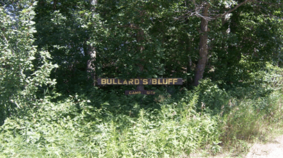 Bullard's Bluff Campground sign in front of trees and brush