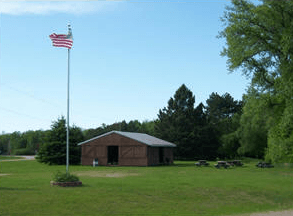 Flag and building at Stigman's Mound Park