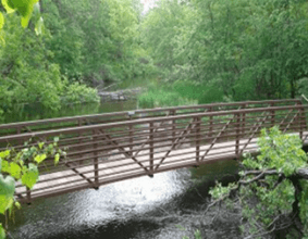 bridge over water at Old Wadena Park Campground